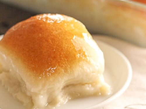 Pani Popo in a pan with a single slice on a plate.
