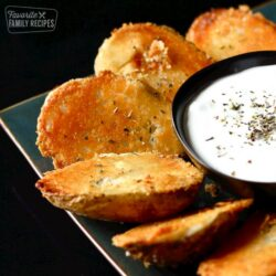 Parmesan Baked Potato Halves with a side of Sour Cream