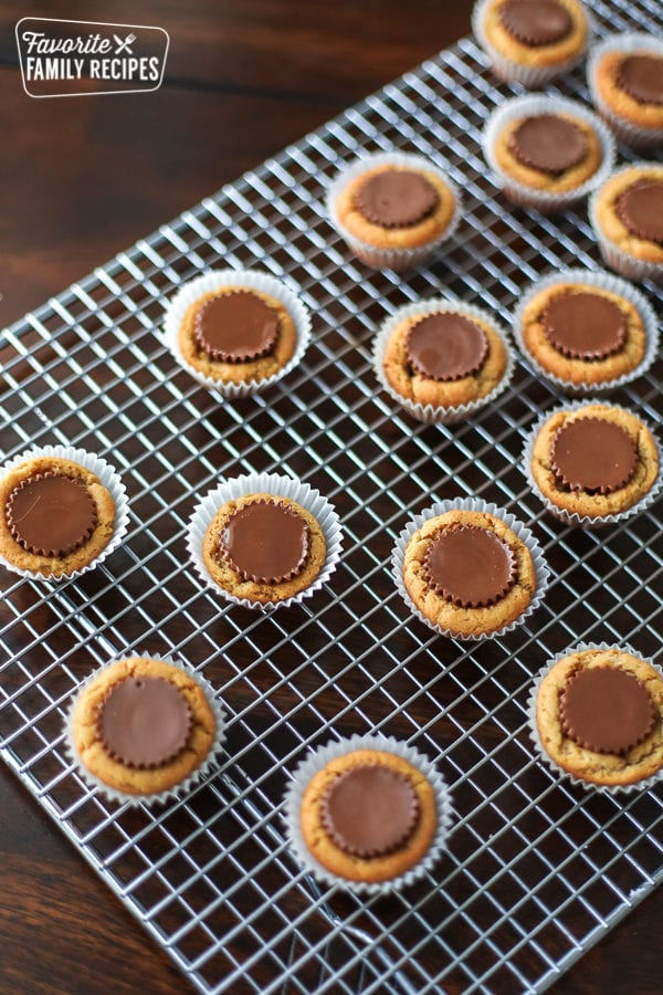 A cooling rack filled with Reese's Peanut Butter Cup Cookies
