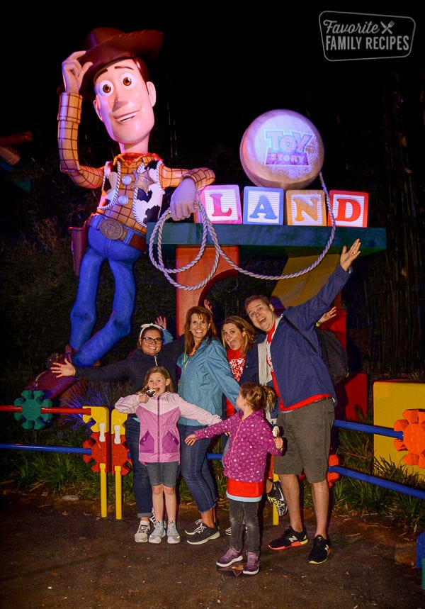 Our family with Woody at the entrance of Toy Story Land