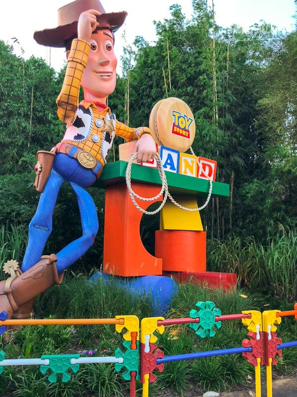 Woody tipping his hat at the entrance of Toy Story Land in Hollywood Studios