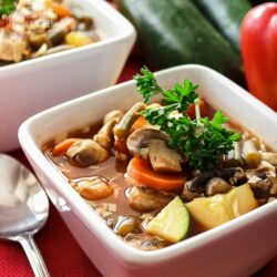 Weight Loss Magic Soup in two serving bowls surrounded by veggies