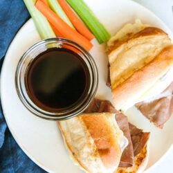 An aerial view of French dip sandwiches with au jus