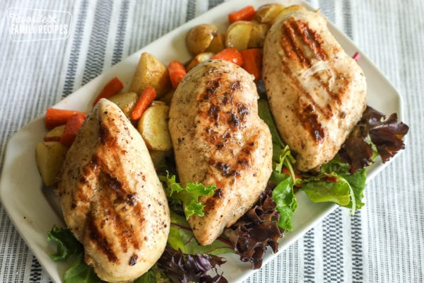 Grilled Lemon Pepper Chicken on a tray with vegetables