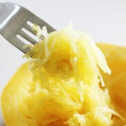 closeup of cooked spaghetti squash on a fork