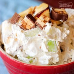 Snickers Apple Salad in a red serving bowl