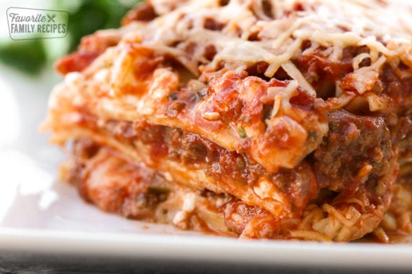 A slice of the best lasagna layered with cheese, meat, and lasagna noodles