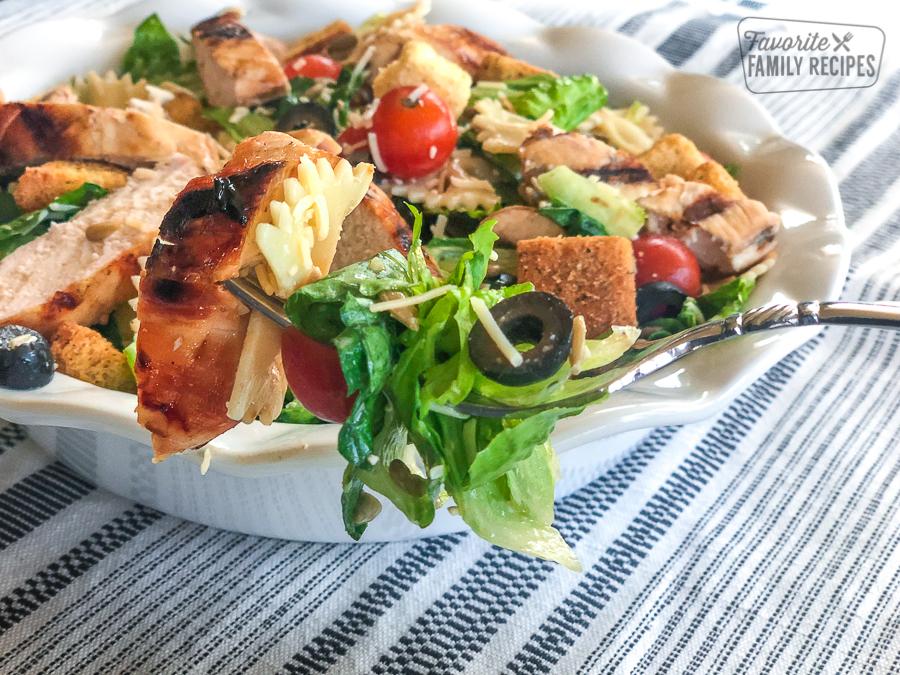 a forkful of chicken caesar pasta salad