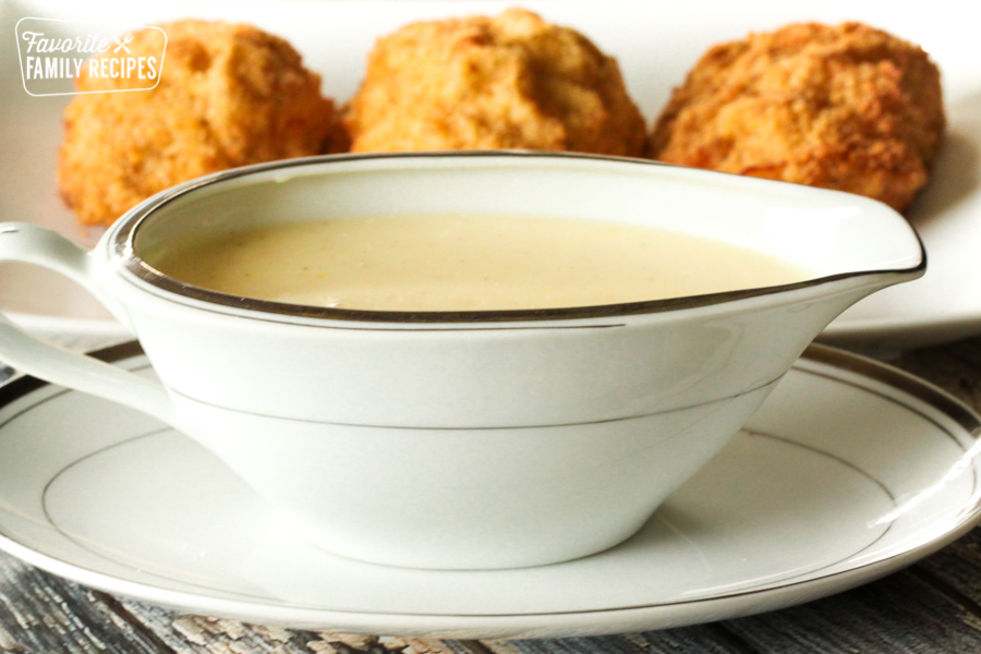 A gravy boat filled with Chicken Cordon Bleu Sauce