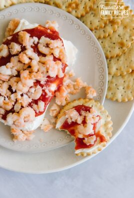 Cream Cheese Shrimp Dip on a cracker with a bite taken out of it