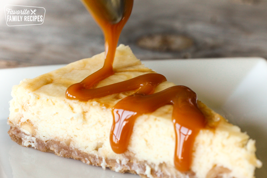 A White Chocolate Cheesecake with caramel being drizzled on top