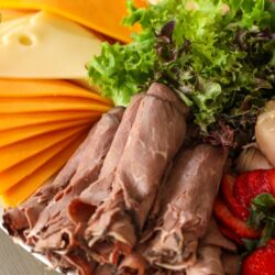 Close up of roast beef on meat and cheese tray