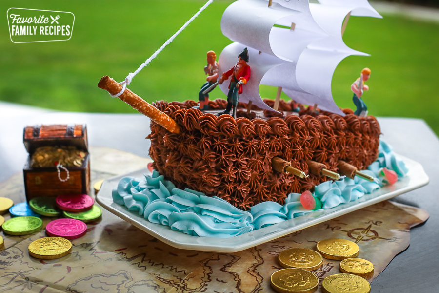 Pirate Ship Cake on a table at a birthday party
