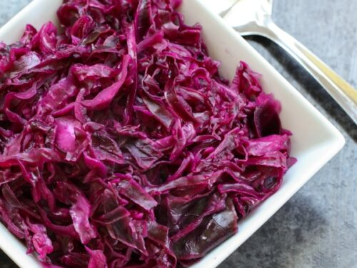 Danish Red Cabbage or Rodkal (Rdkal) served in a white square bowl with a spoon to the side