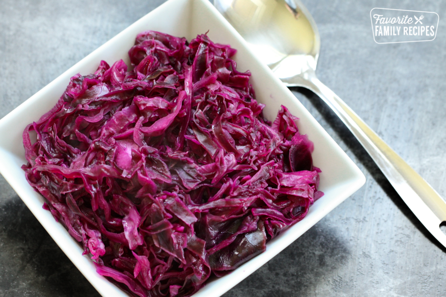 Danish Red Cabbage or Rodkal in a white bowl with a spoon to the side