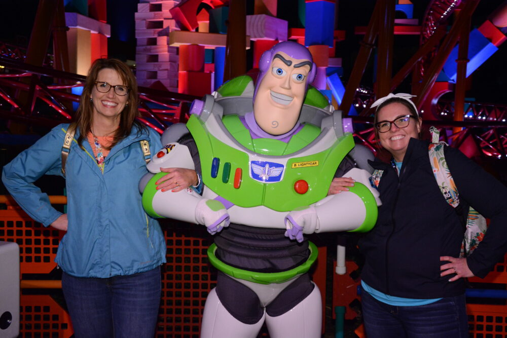Echo and Emily with Buzz Lightyear in Toy Story Land Hollywood Studios