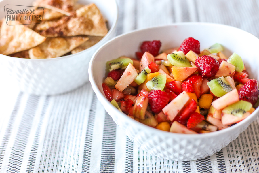 A bowl of fruit salsa and a bowl of cinnamon chips