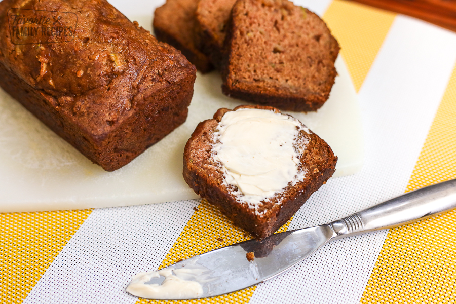 Gluten Free Zucchini Bread sliced with butter spread on it