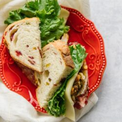 Pilgrim Sandwich cut in half with Cranberry Pistachio Hearth Bread
