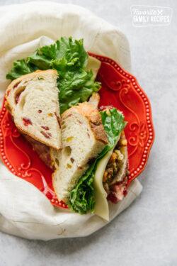 Pilgrim Sandwich cut in half with Cranberry Pistachio Hearth Bread