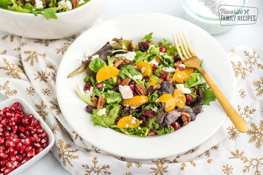 Christmas Salad with Poppyseed Dressing and a bowl of pomegranates