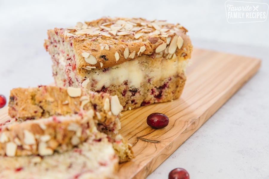 Cranberry bread with cream cheese swirl on a cutting board