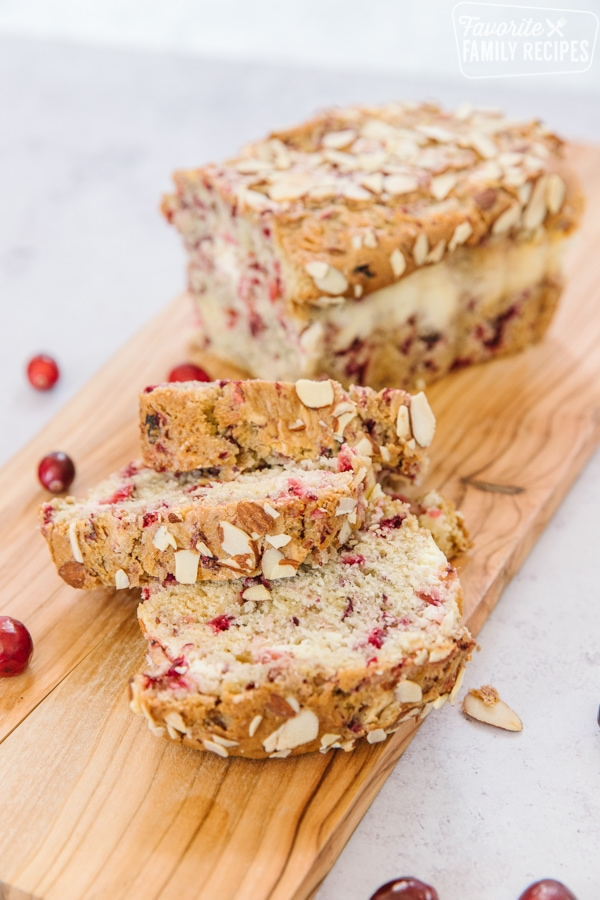 Cranberry bread with slices on a board