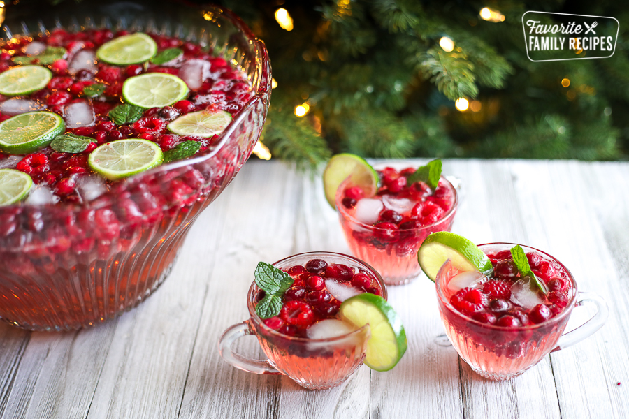 Holiday punch in a punch bowl in front of a Christmas tree
