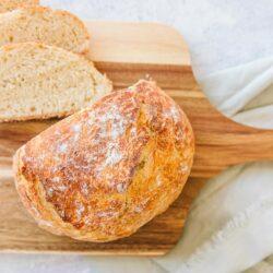 Dutch oven bread on a wood cutting board