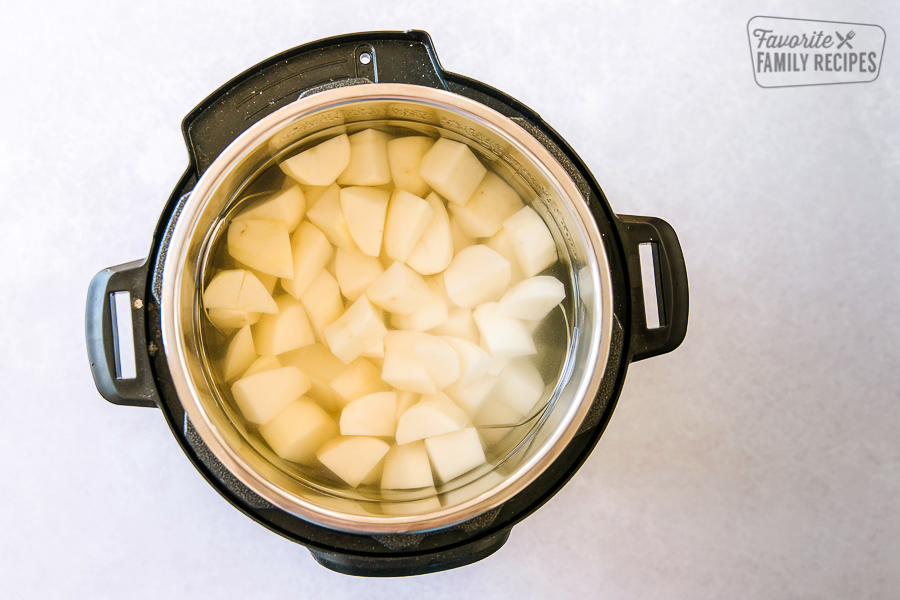 Cut up potatoes and water in an instant pot.