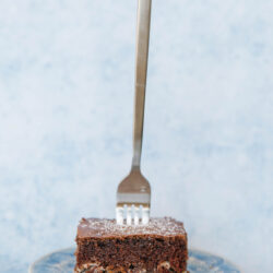 A fork stuck in the center of a slice of German Chocolate Cream Cake