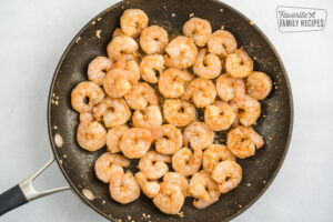 Shrimp in a pan with butter, garlic, and cajun seasoning