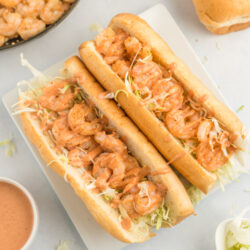 Two shrimp po boys on a plate