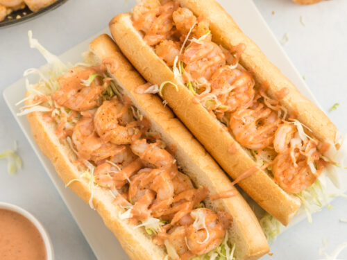 Two shrimp po boys on a plate