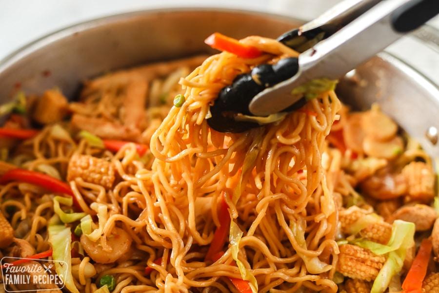 Yakisoba noodles in a skillet being served