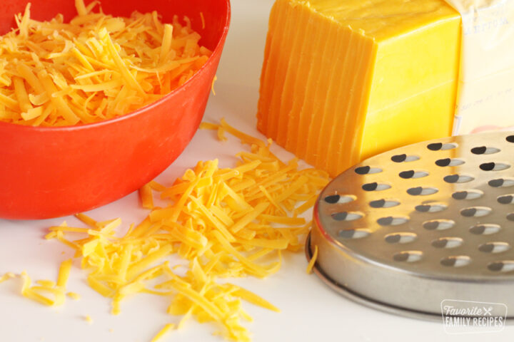Block of cheddar cheese that has been shredded