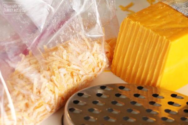 Shredded cheddar cheese for freezing