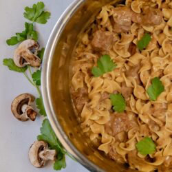 Beef Stroganoff in an Instant Pot with mushrooms and parsley leaves