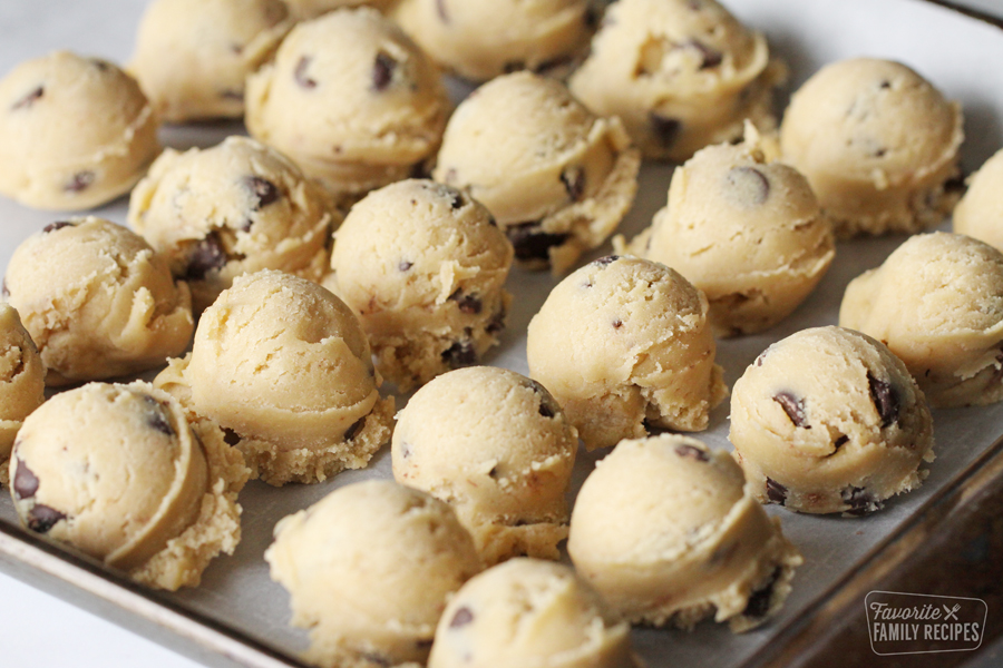 Cookie dough scoops on a baking sheet