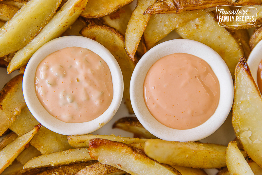 Two kinds of fry sauce on a tray of fries