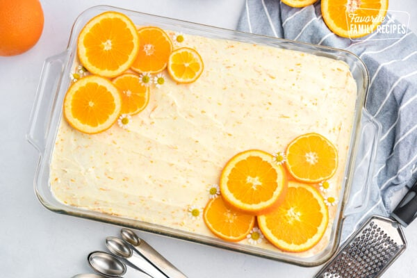 Sunny Yellow Cake in a glass pan topped with orange slices and flowers
