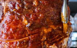 Basting sauce over spiral cut ham