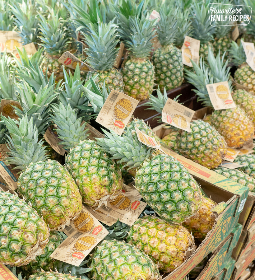 A stack of pineapples at the grocery store.
