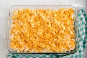 Unbaked Cheesy Potato Casserole in a glass baking dish