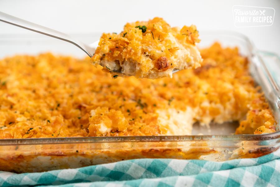 A scoop of cheesy potato casserole
