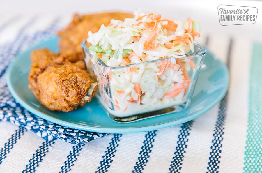 KFC Coleslaw served in a clear dish with chicken on the side