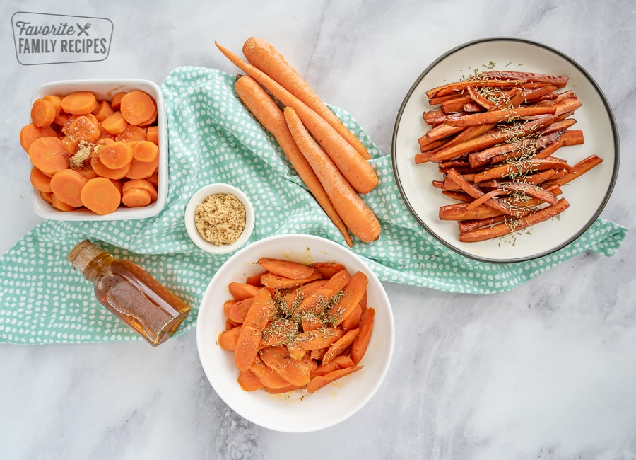 Three plates of glazed carrots on a marble background