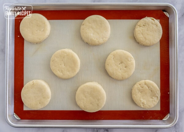 biscuits before they are cooked on a baking sheet