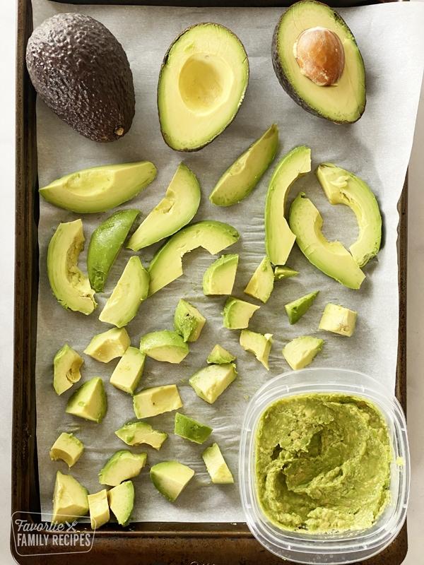 Avocado on a baking sheet ready to freeze