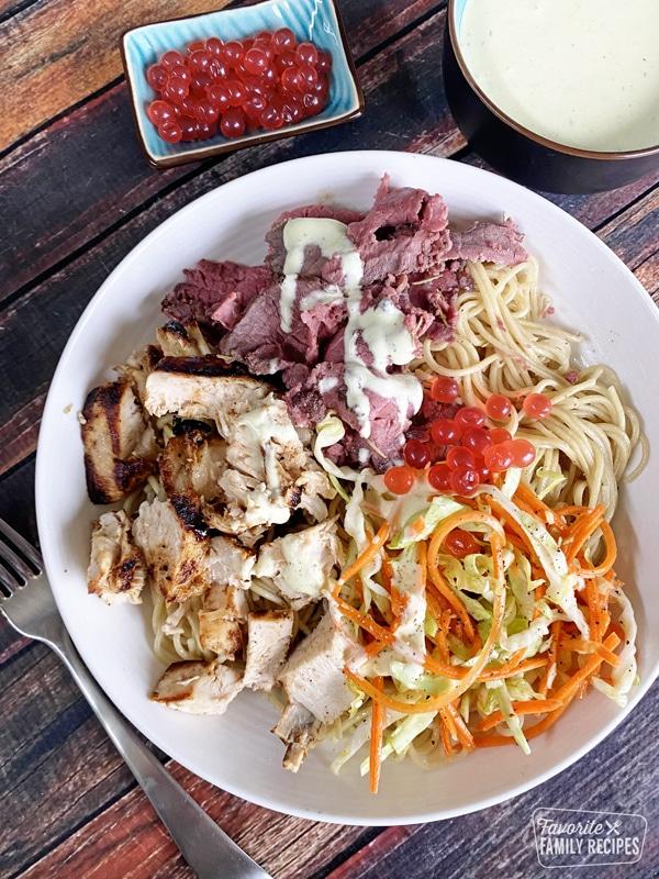 Satuli bowl with boba balls, chicken, beef, and veggies
